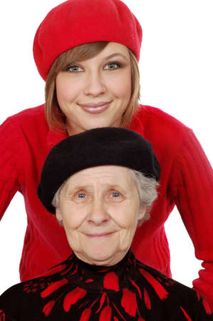 berets: happy grandmother and granddaughter with berets. isolated over white