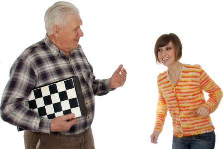 grandad: grandad called granddaughter to play a chess. isolated on white Stock Photo