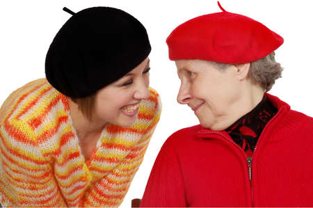 berets: happy grandmother and granddaughter with berets. isolated on white
