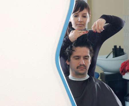 barber at the work. view from mirror Stock Photo - 4259547