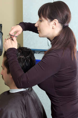 hairdresser make clips to the men photo