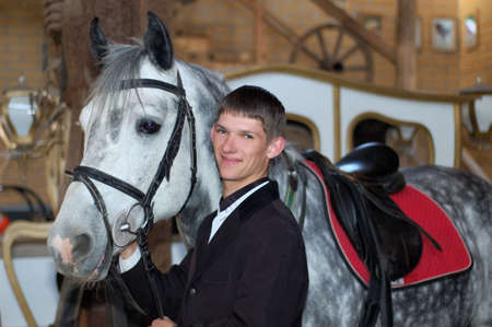 girth: young rider with race-horse