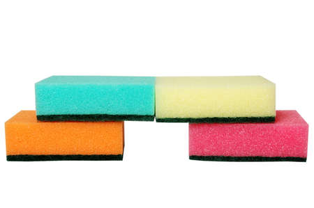 four multicolor sponges. isolated on white photo