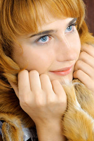 Portrait of pretty smiling blue-eyed foxy woman photo