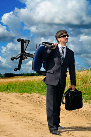 takes: Young successful businessman takes his work to field Stock Photo