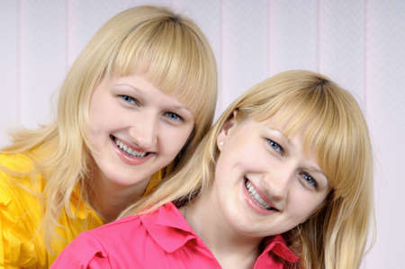 Portrait of two beautiful smiling blond sisters Stock Photo - 4302879