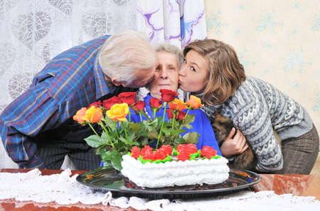 grandfather and grandmother: granddaughter and grandfather kissing grandmother