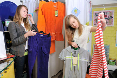 Girls pick out clothes to buy Stock Photo - 4537892