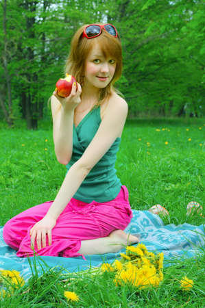 coverlet: pretty girl with apple on coverlet