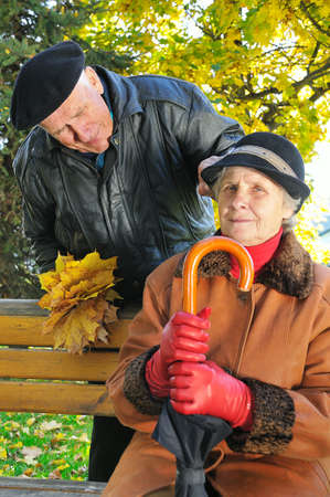 beautiful couple grandparents in park photo