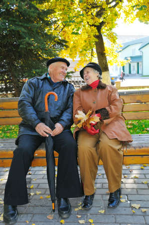 happy grandparent on bench in park photo
