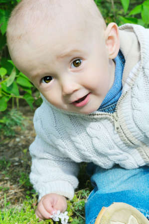 inoffensive: pretty baby sit on grass