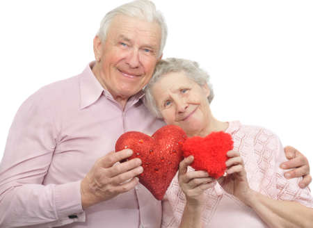 happy old couple with red hearts on white background photo
