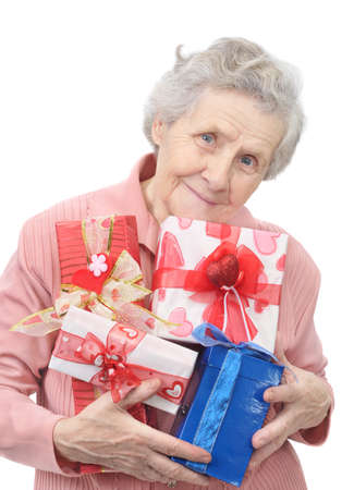 old lady and boxes with gifts on white background Stock Photo - 9410179