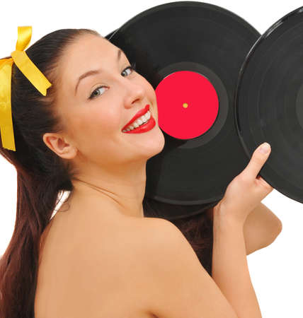 dischi: beauty smiling young woman with vinyl discs on white background Archivio Fotografico