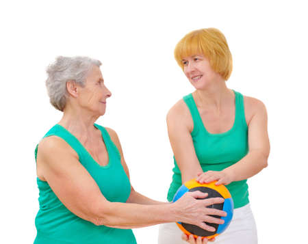excitation: daughter and mother doing gymnastics with ball on white background