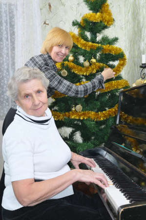 granny and daughter prepare to Christmas at home photo