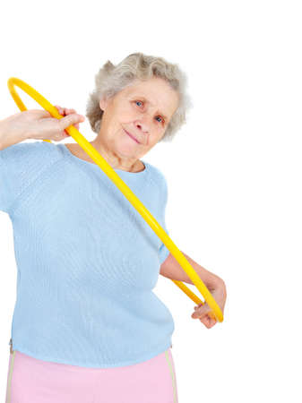 75s: old woman doing gymnastic with hula-hoop Stock Photo