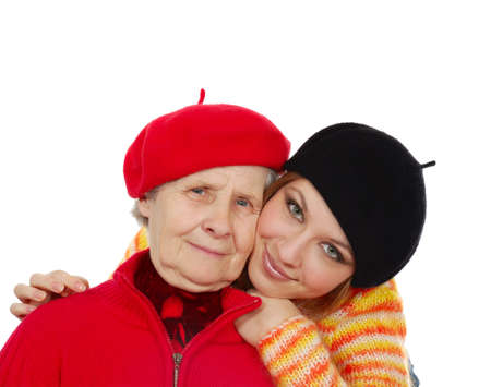 happy grandmother and granddaughter with berets. isolated on white photo