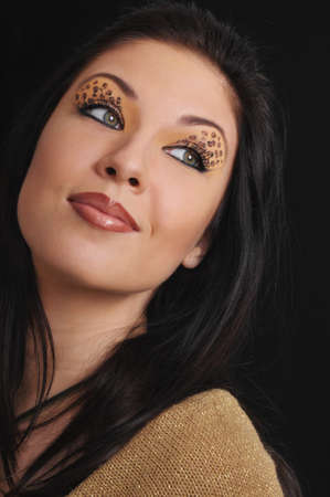 portrait of beautiful young womanl with beautiful leopards make-up photo