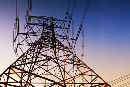megawatts: High voltage post or High voltage tower at sunset