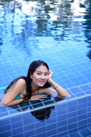 Woman enjoy relaxing in the pool photo