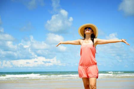 Woman enjoying on the beach photo