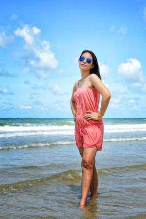 Woman enjoy relaxing on the beach photo