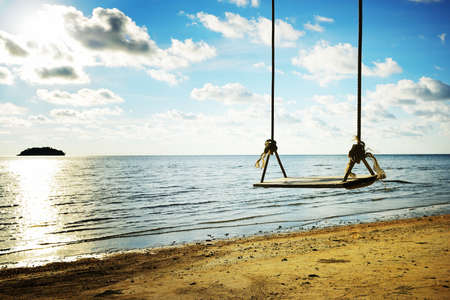 Swing hang on a tree beside the beach in Thailand photo