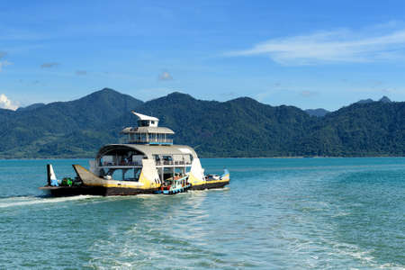 speed of sound: Ferry boat carry passenger to the island Stock Photo
