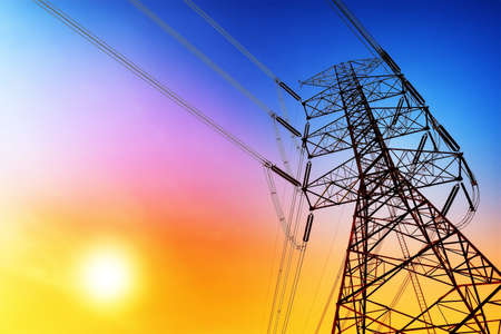 conductor electricity: High voltage post or High voltage tower at sunset