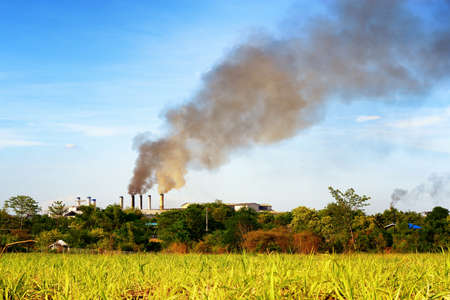 pollution: Air pollution by smoke coming out of factory Stock Photo