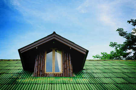 Room under the roof with dark wooden photo