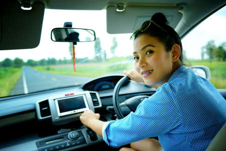 Business woman in car on the road Stock Photo