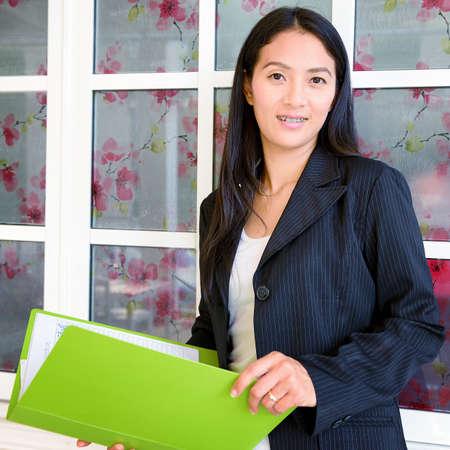 Business woman hold a folder photo
