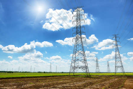 High voltage post or High voltage tower in green field photo