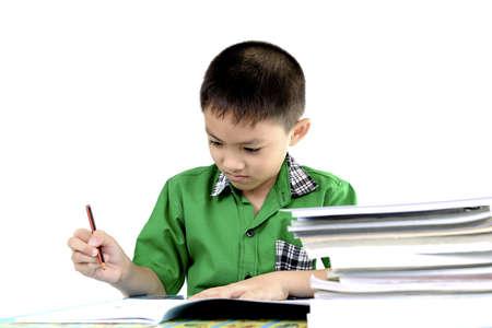 Student boy enjoy doing homework Standard-Bild