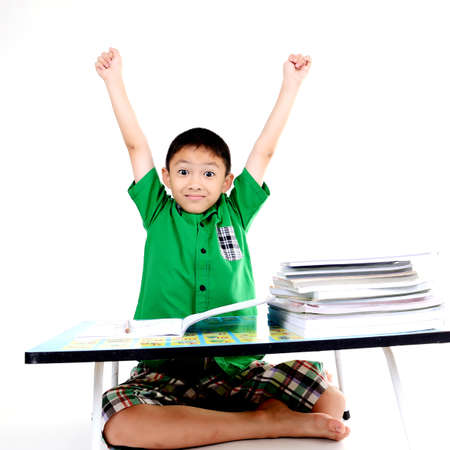 learning by doing: Student boy happy after finished homework