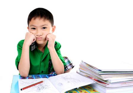 examination stress: Student boy tired to do homework