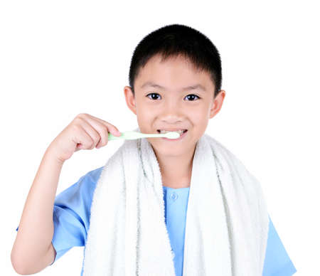 tooth paste: Asian boy brushing teeth, isolated on white background