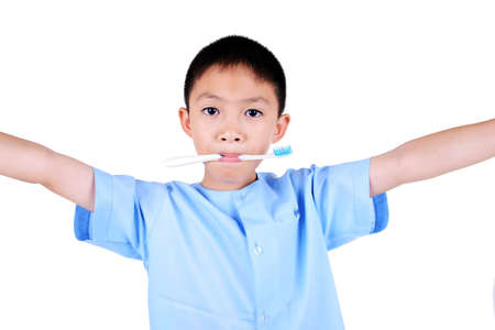 Asian boy brushing teeth, isolated on white background photo