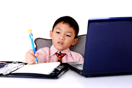 Business boy writing document in office photo