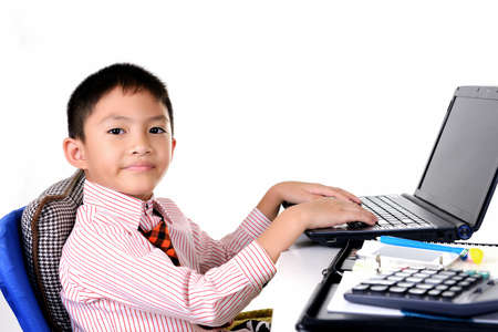 Business boy working with laptop Stock Photo - 22170347