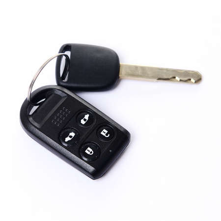 Car key with remote control on white background