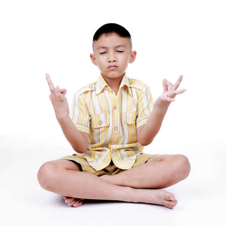 Boy in a lotus pose meditation and yoga Stock Photo - 22170361