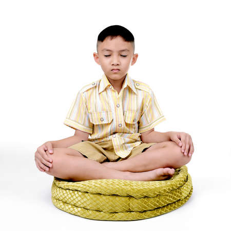 Boy in a lotus pose meditation and yoga Stock Photo - 22170363