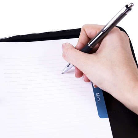 Hand writing in notebook Stock Photo - 22170782