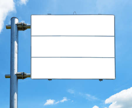 Blank road sign against blue sky background photo