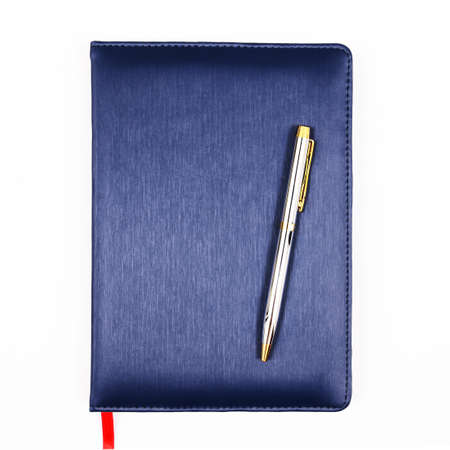 daily planner: Blue leather notebook with pen isolated on white background