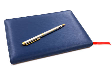 Blue leather notebook with pen isolated on white background